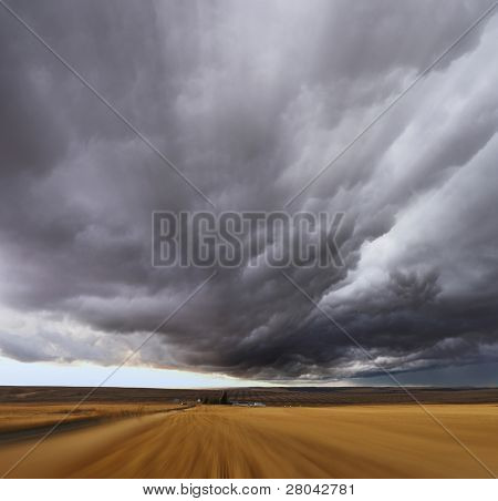 Thunderstorm above fields after harvesting.  A Mirage on high speed