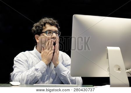 Male Office Worker In Front Of A Computer Made A Mistake In The Calculation. Stress, Fright, Facial