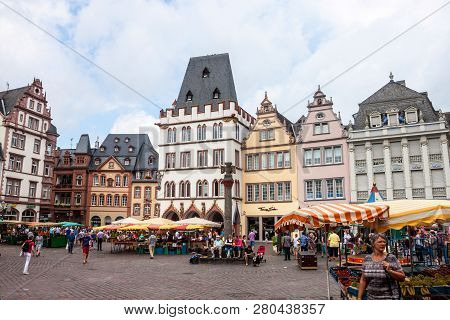 Trier, Germany- August 3: People And Stalls At Market Square In Trier, Germany, On August 3, 2013. T