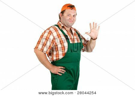 Cheerful Worker In Overalls And A Baseball Cap