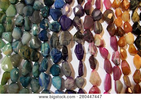 Many Necklaces Of Natural Stones As A Natural Background