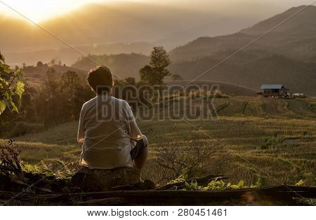 The Back Of Senior Woman Watching The View Rice Field Near Mountain At Mae Chaem, Chiang Mai In Time