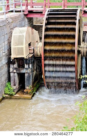 Water Wheel In Operation At The Locks On Canal To Operate  A Gristmill