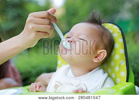 First Time Infant Baby For Feeding Food.