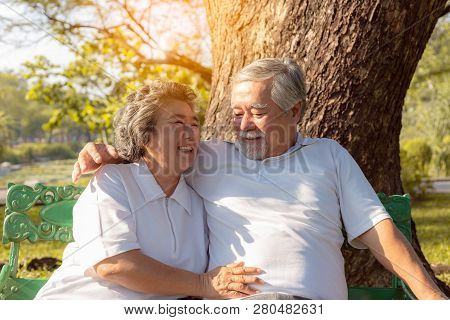 Happy life and long lived concept. Beautiful older woman feel happiness when grandma stay with beloved husband or grandfather. Charming grandparent love each other for long time. They have good health poster