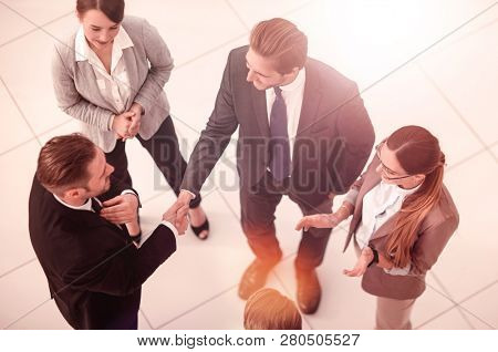 top view.handshake business partners before a business meeting