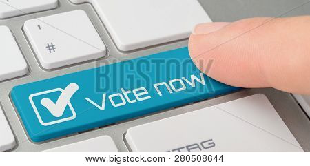 A Keyboard With A Blue Labeled Button - Vote Now