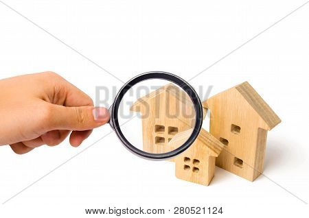 Three Wooden Houses On A White Isolated Background. Real Estate Concept. Search And Sale Of Housing.