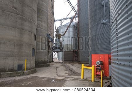 Agricultural Industrial Background. Huge Metal Grain Silos In The Heartland Of The American Midwest.