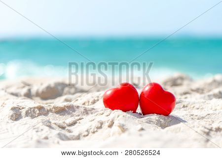 Valentine And Marry Concept. Two Red Hearts Couple Lovers For Married On The Sand Summer Beach, Blue