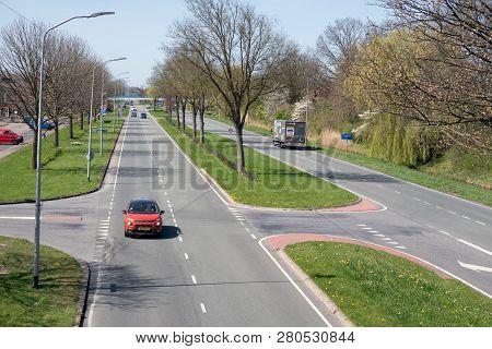 Lelystad, The Netherlands - April 18, 2018: Major Road In Early Springtime Along Park In Lelystad, C