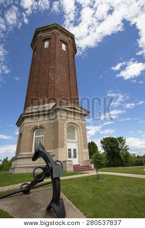 Historic Water Tower. The Historic Brick Water Tower  In Manistique Michigan, Now Serves As The Scho
