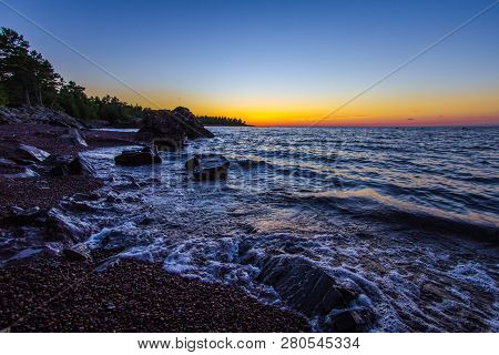 Lake Superior Twilight Beach. Beautiful Sunset Colors On A Remote Rocky Beach On The Coast Of Lake S