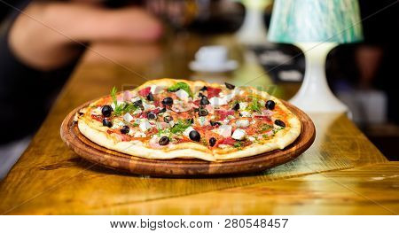 Pizzeria Restaurant. Italian Pizza Concept. Delicious Hot Pizza On Wooden Board Plate. Food Delivery