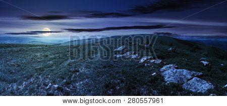 Panorama Of Beautiful Carpathian Alpine Meadows At Night In Full Moon Light. Wonderful Summer Landsc