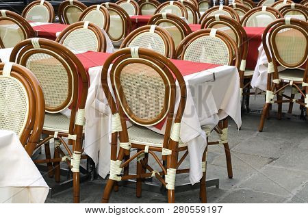 Tables And Chairs At Alfresco Elegant Restaurant But Wihtout People