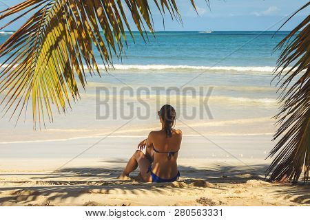 Traveler Girl Relaxing On Tropical Beach. Young Girl Traveler Relaxing In Vacation. Traveler Relaxin