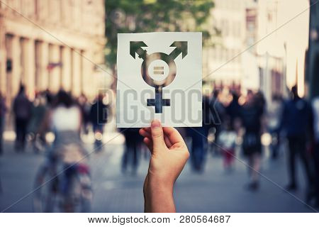 Hand Holding A Paper Sheet With Transgender Symbol And Equal Sign Inside. Equality Between Genders C