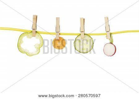 Radish, Cucumber, Carrot And Pepper On Clothesline Isolated, Healthy Eating Concept
