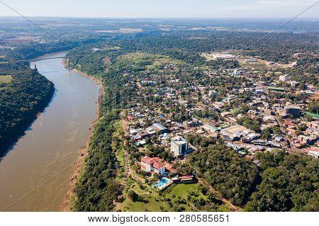 Town Of Puerto Iguazú City Centre Aerial View. Tancredo Neves Bridge (fraternity Bridge) Border Cros
