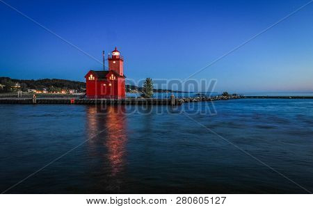 Holland Michigan Lighthouse At Night. The Beautiful Big Red Lighthouse At Holland State Park At Nigh