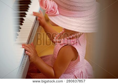 Girl Play Digital Piano. Child In Vintage Pink Hat, Dress, Bead Necklace At Keyboard. Music Class, S