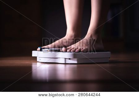 Feet On Scale. Weight Loss And Diet Concept. Woman Weighing Herself. Fitness Lady Dieting. Weightlos