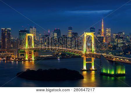 Tokyo Skyline With Rainbow Bridge And Tokyo Tower. Tokyo, Japan.