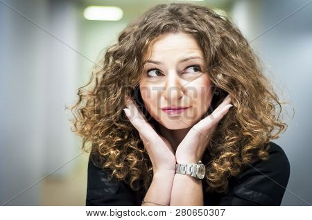 Cute Caucasian Girl Embracing Her Face With Hands, Close Up Portrait.