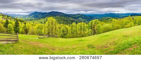Panorama Of Mountainous Countryside In Springtime. Beautiful Highland Landscape. Wooden Fence On The