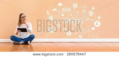 Cryptocurrency Fintech Theme With Young Woman Holding A Tablet Computer