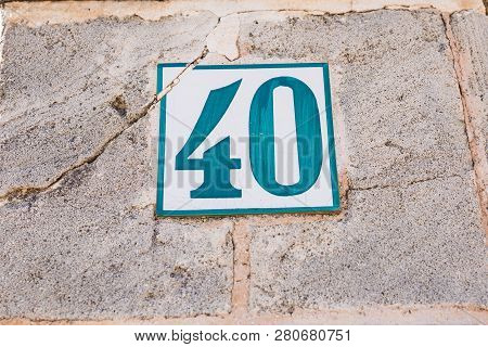 Blue White Vintage House Number Forty 40 On A Old Aged Wall