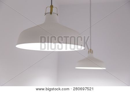 Two Classic Hanging Lamp On The Ceiling. White Photo.