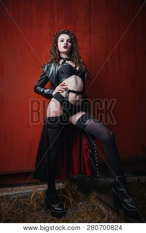 Gothic Fashion: Portrait Of A Sexy Pretty Girl (informal Model) In Leather Coat, Stockings And Linge
