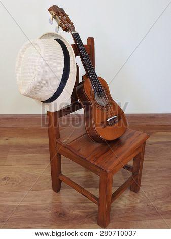 A Samba Player (sambista) Hat And A Cavaquinho (a Small Brazilian String Musical Instrument) In A Sm