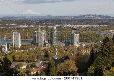 Portland, Oregon - April 14, 2014:  A Tram Car View Of City Buildings, The Willamette River And A Di