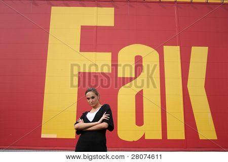 fashion girl near big wall