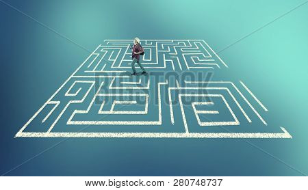 Man Running Through The Middle Of A Labyrinth. The Concept Of Shortcut And Working Smart.