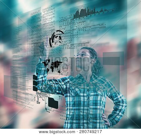 Woman Using Futuristic Touch Screen Computer On Colorful Background.