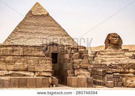 Egyptian Great Sphinx Full Body Portrait Head, With Pyramids Of Giza Background Egypt Empty With Nob