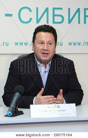 TOMSK, RUSSIA - December 4: George Ageev - Director of the National Philharmonic Orchestra of Russia at a press conference in agency Interfax-Siberia, December 4, 2009 in Tomsk, Russia.