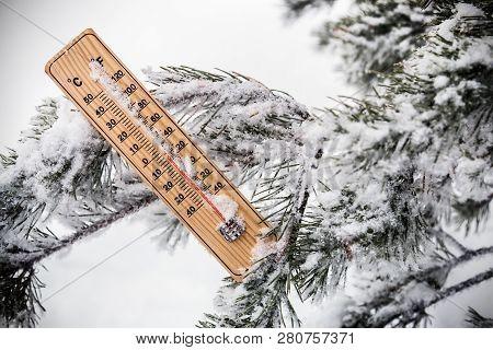 Thermometer With Subzero Temperature Stuck In The Snow