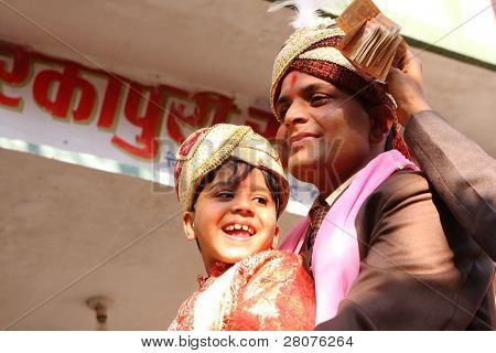 HARIDWAR, INDIA - JANUARY 14: The groom (R) and his little friend (L) in a traditional Indian wedding, January 14, 2009 in Haridwar, India.