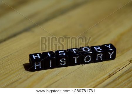 History Written On Wooden Blocks. Inspiration And Motivation Concepts. Cross Processed Image On Wood