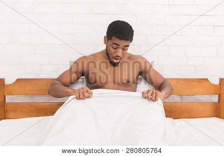 Trouble With Erection. Young African-american Man In Bed Having Problems With Potency, Looking At Hi