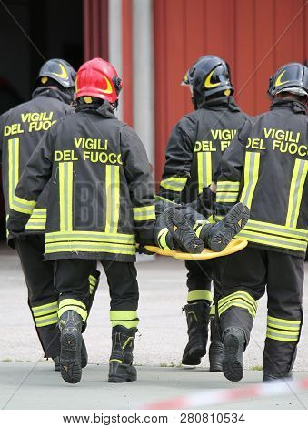 Vicenza, Vi, Italy - May 10, 2018: Stretcher Bearers Firefighters Transport An Injured On The Stretc