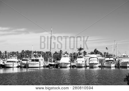 Key West, Usa - February 08, 2016: Yachts And Sailing Ships Moored At Sea Pier On Sunny Blue Sky. Ya