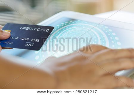 One Hand Holding Credit Card Mockup And Another Hand Touch On Tablet. Consumer Can Buy Products Anyw