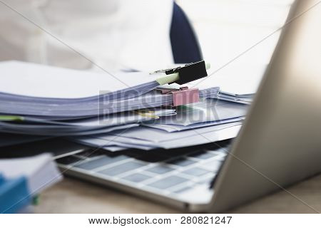 Pile Of Unfinished Homework Assignment And Report Separated By Color Binder Paper Clip On Teacher's