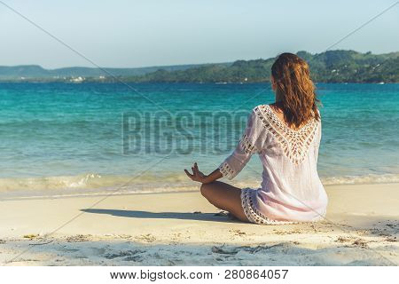 Girl Doing Yoga On Tropical Beach. Yoga On The Beach. Yoga Lifestyle. Healthy Lifestyle. Girl Doing